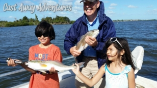 Family fishing in Cocoa Beach